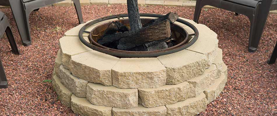 Custom stacked stone wood burning fire pit at a home in South Bend, IN.