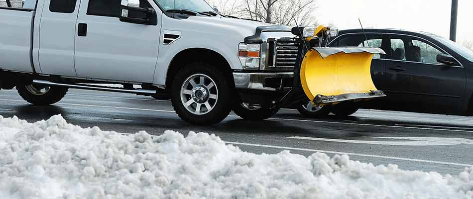Work truck with snow plow attachment dispatched to remove snow at a commercial property in Granger, IN.