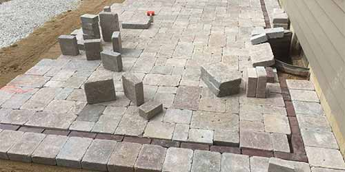Custom paver patio and fire pit design in Granger, IN.